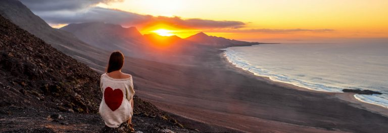 Woman enjoying beautiful landscape on Fuerteventura island