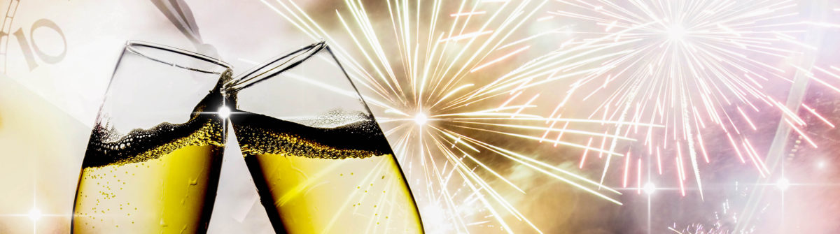 glasses-with-champagne-against-fireworks-and-clock-close-to-midnight-shutterstock_122288275-2
