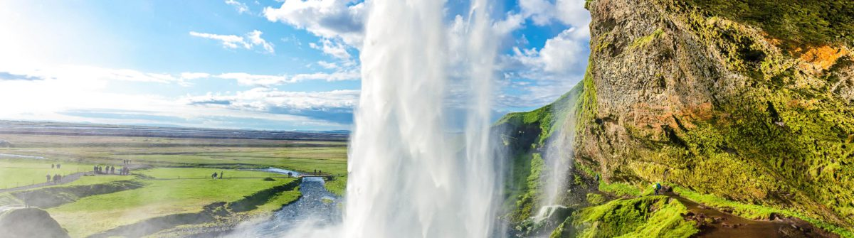 at the back of seljalandsfoss in iceland shutterstock_307918913-2