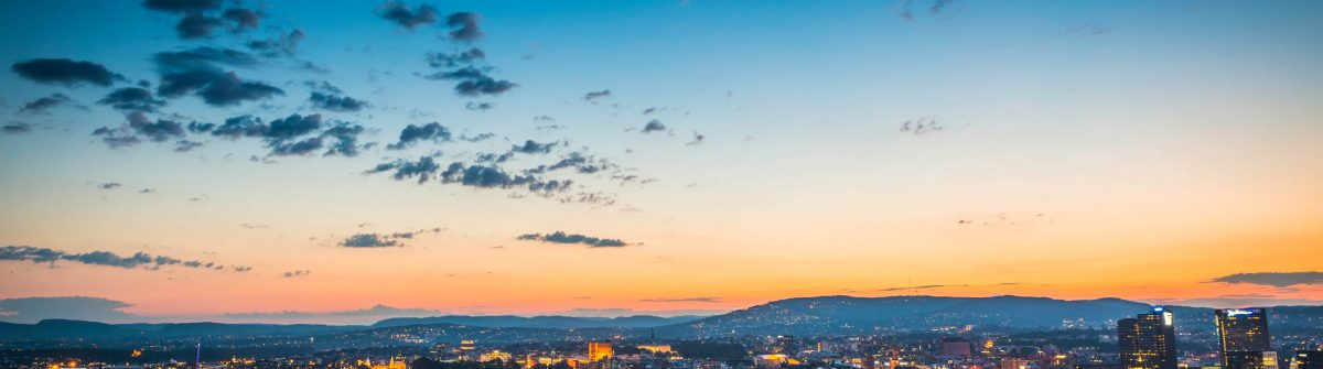Oslo city lights illuminated under blue chrome dusk sky Norway iStock_000055261494_Large-2