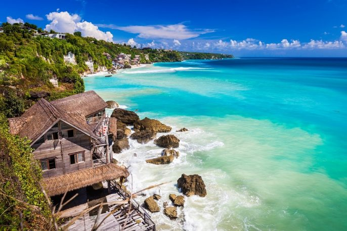 Azure-beach-with-rocky-mountains-and-clear-water-of-Indian-ocean-at-sunny-day-Bali-Indonesia-shutterstock_459773704