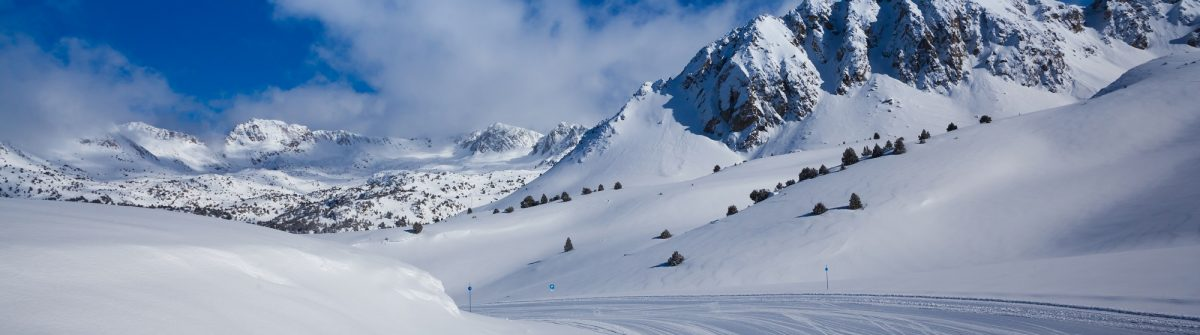 Fresh ski slope and mountains in sunny day_shutterstock_200674709