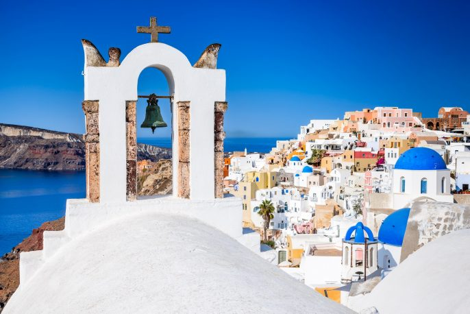 Oia, Santorini – Greece. Famous attraction of white village with cobbled streets, Greek Cyclades Islands, Aegean Sea shutterstock_722921995