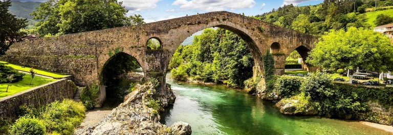 Old-Roman-stone-bridge-in-Cangas-de-Onis-Asturias-Spain_151453073_1920x1280