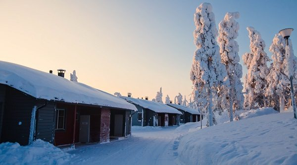 Beautiful lapland winter landscape with cottage cabin village in christmas
