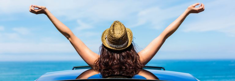 Woman on car travel enjoying freedom