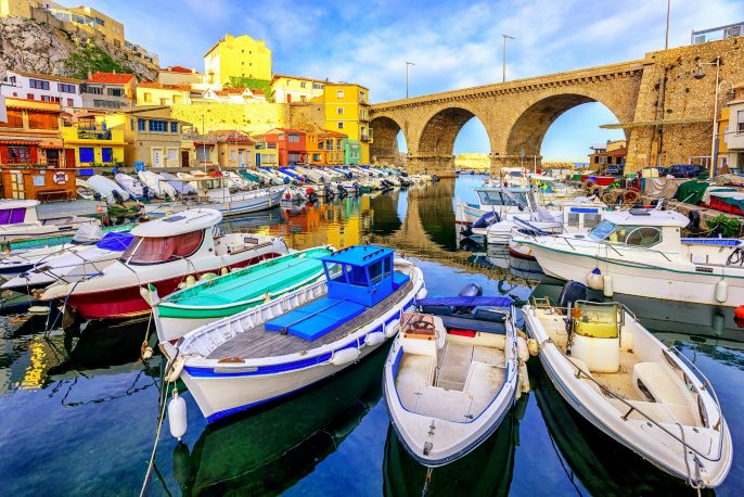 Small fishing harbor Vallon des Auffes with traditional picturesque houses and boats, Marseilles, France_435193492