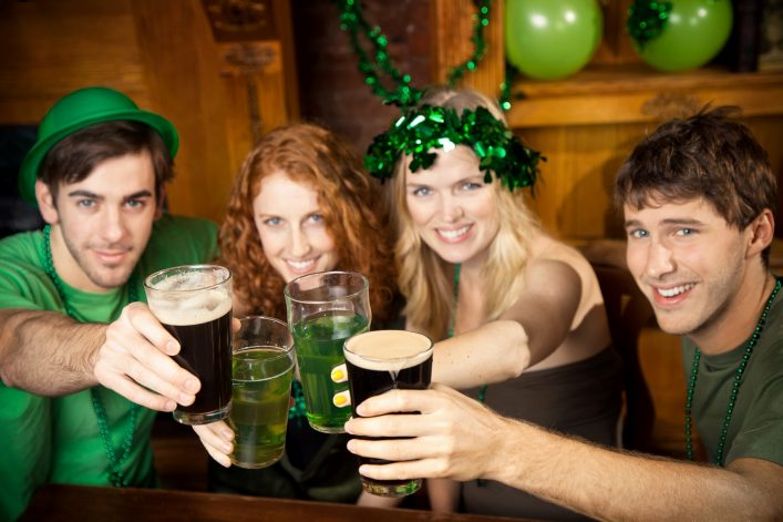 Group of friends celebrating St. Patrick's Day at a pub_shutterstock_141719404 – Copy