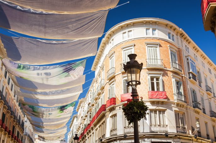 Sunny view of Larios street in Malaga, Andalusia province, Spain_shutterstock_418720603