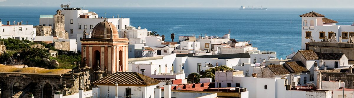 Village of Tarifa, located in the Strait of Gibraltar. In the background you can see Africa_554028832