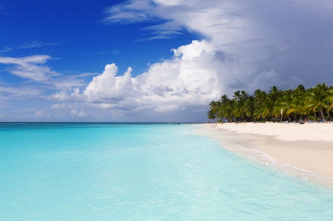 Beach-on-the-tropical-island.-Clear-blue-water-sand-and-palm-trees.-Beautiful-vacation-spot-treatment-and-aquatics.-Copy