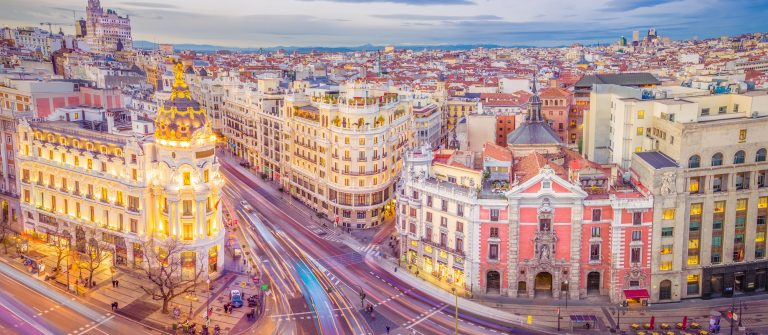 Downtown Madrid, Spain, where the Calle de Alcala meets the Gran Via. These are two of the most famous and busy streets in Madrid_554453284