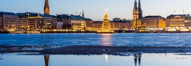 Hamburg town hall and Alster Lake with Christmas market