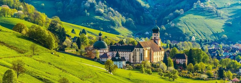Beautiful-countryside-mountain-landscape-with-a-monastery-in-village-shutterstock_286284614-2_900x600