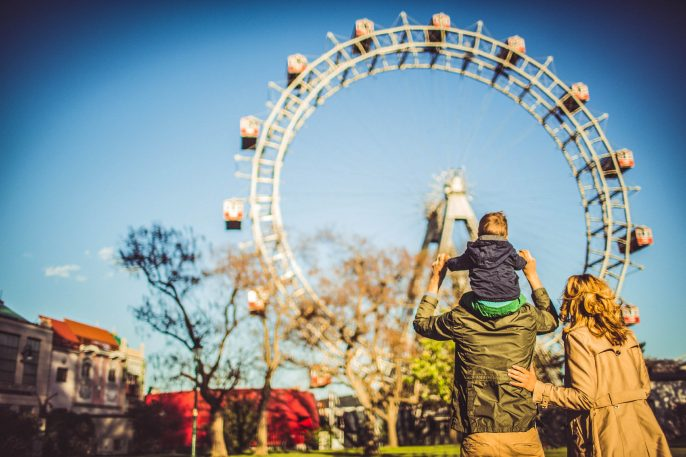 Family-in-the-amusement-park-iStock_000066166599_Large-2