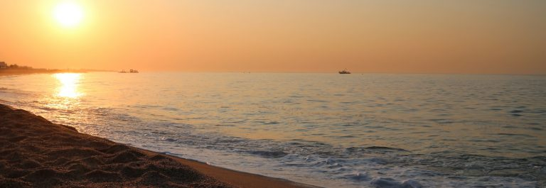 Beautiful sunrise over the Mediterranean Sea in Malgrat de Mar, Spain._669298627