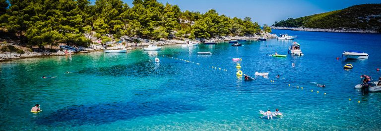 «People playing, swimming at sea, bay, Summer Resort, Hvar, Croat»