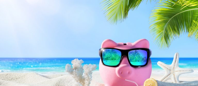Piggy-Bank-With-Drink-On-The-Palm-Beach-Holidays-In-Economic_410849932
