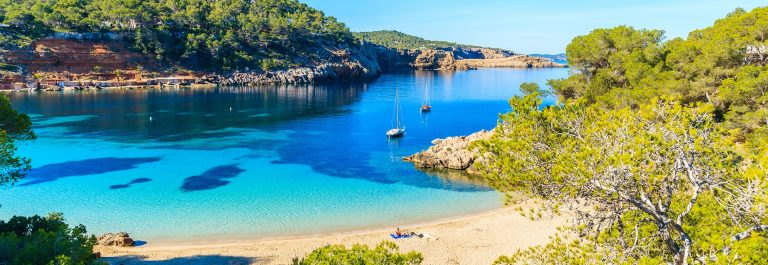 Beautiful-beach-in-Cala-Salada-famous-for-its-azure-crystal-clear-sea-water-Ibiza-island-Spain-shutterstock_654922006