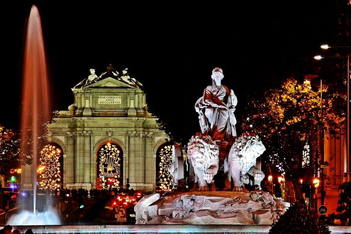 Fountain-of-Cibeles-and-Puerta-de-Alcala-in-Madrid-Spain-illuminated-in-a-Christmas-night.-shutterstock_1141796165
