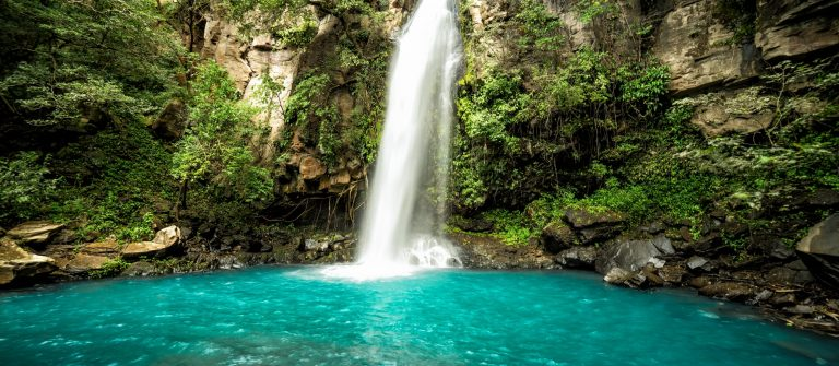 Majestic-waterfall-in-the-rainforest-jungle-of-Costa-Rica.-La-Cangreja-waterfall-in-Rincon-de-La-Vieja-National-Park-Guanacaste_liberia_561732055