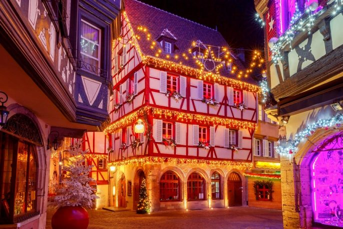Traditional-old-half-timbered-houses-in-the-historic-city-of-Colmar.-Decorated-and-lighted-during-the-Christmas-season.-Alsace.-France_shutterstock_652348360_900x600