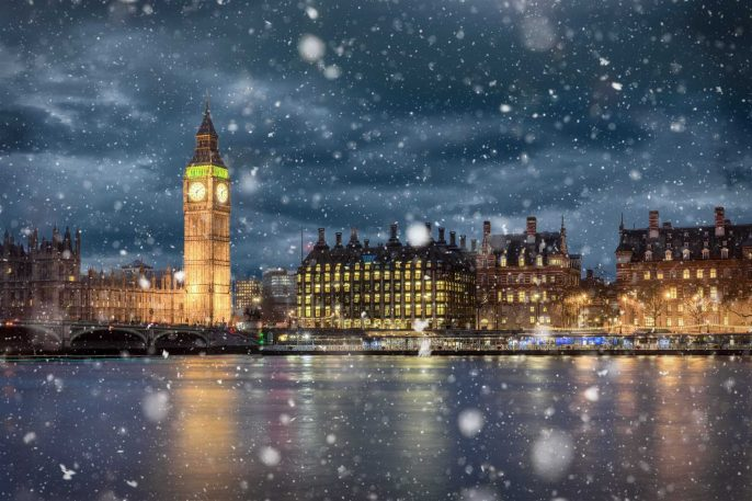 Big-Ben-and-Westminster-on-a-cold-winter-night-with-falling-snow-London-United-Kingdom_shutterstock_714423985_1920x1280