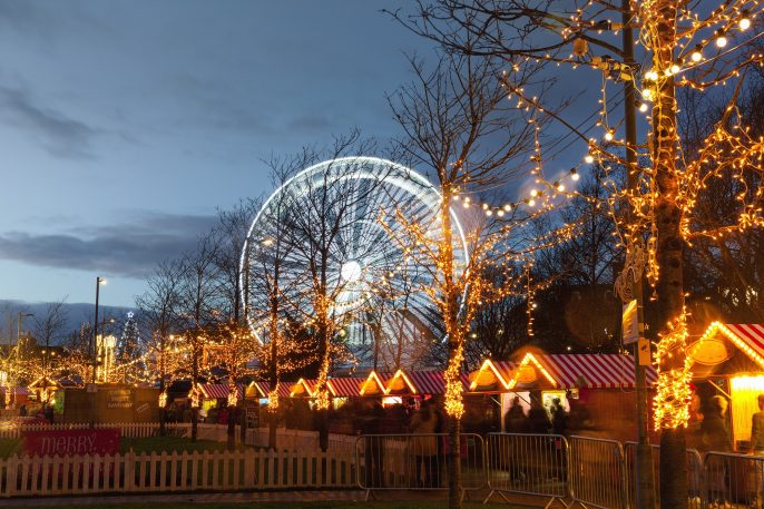 Christmas-Market-with-big-wheel-illuminated-at-night.-Galway-Ireland-shutterstock_768449800