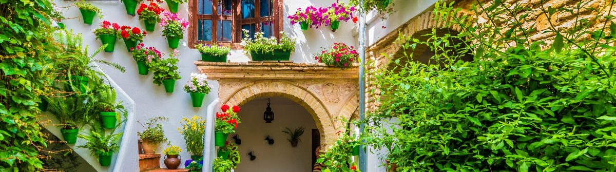 Traditional-house-and-courts-with-flower-in-Cordoba-Spain-shutterstock_561322894