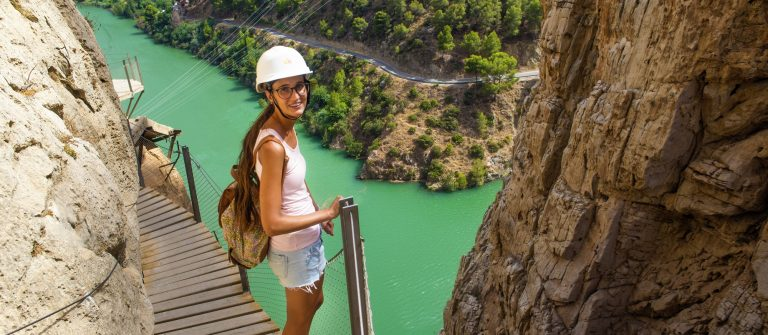Woman-hiking-in-mountainous-area-in-the-Caminito-del-Rey-Malaga-Spain._312176381-x2000