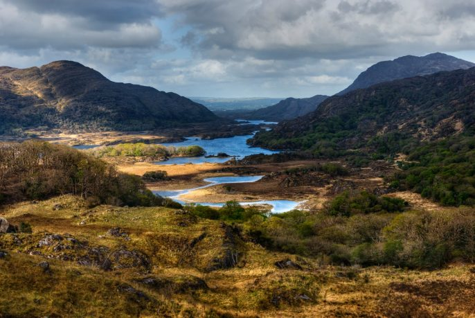 Distant-view-over-lakes-and-mountains-in-Ring-of-Kerry-Ireland-shutterstock_299467769_resize