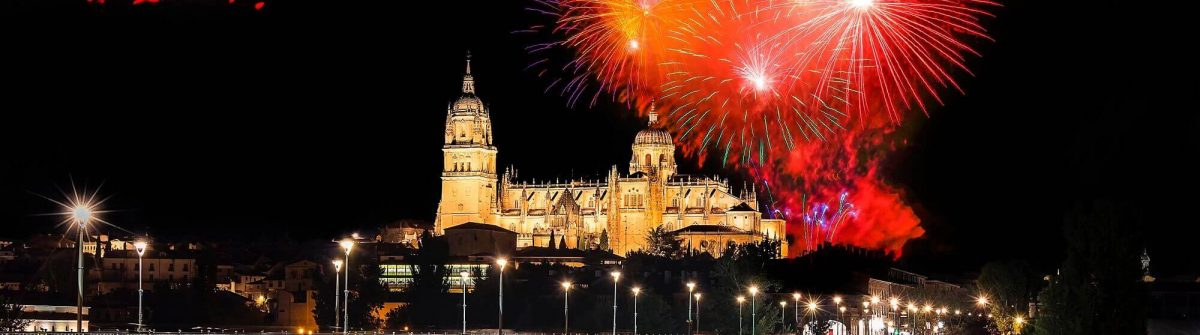 View-of-Fireworks-over-Salamanca-Cathedral-from-Enrique-Esteban-Bridge-over-Tormes-River-shutterstock_1086987596-1