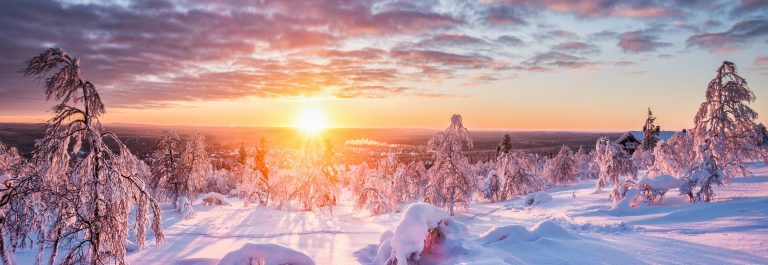 Panoramic-view-of-beautiful-winter-wonderland-scenery-in-scenic-golden-evening-light-at-sunset-with-clouds-in-Scandinavia-northern-Europe_1022646601