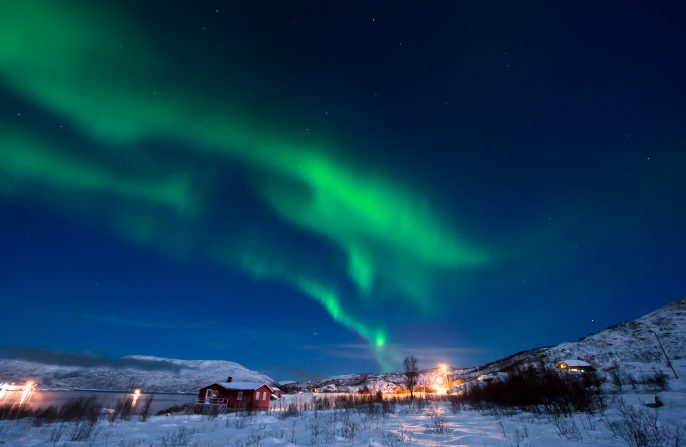 Northern-Lights-in-the-sky-Night-Scene-Tromso-Norway.-also-visible-Ursa-Major_372459805