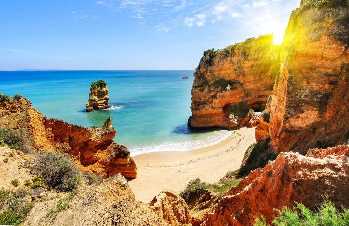 Rocky-beach-at-sunset-Lagos-Portugal-shutterstock_289549745-2