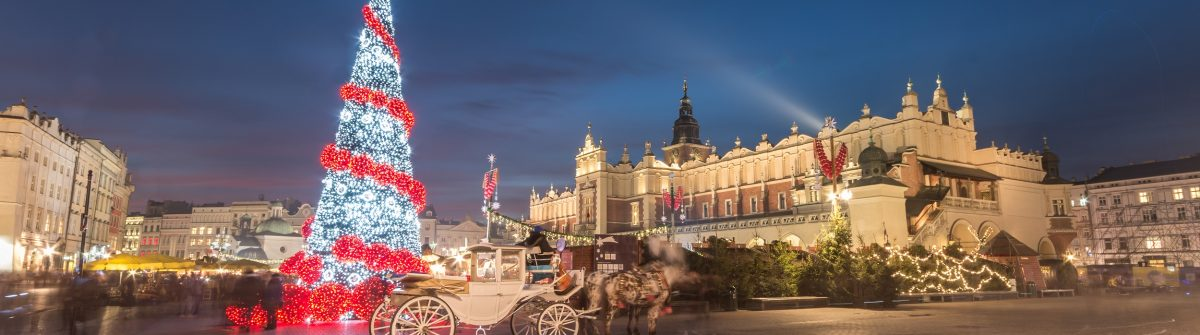 Krakow-Poland-Main-Market-square-and-Cloth-Hall-in-the-winter-season-during-Christmas-fairs-decorated-with-Christmas-tree._shutterstock_350894495-smaller