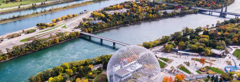 Aerial-view-of-Montreal-showing-the-Biosphere-Environment-Museum-and-Saint-Lawrence-River-during-Fall-season-in-Quebec-Canada-shutterstock_1205629267