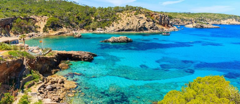 Amazing-view-of-Cala-Xarraca-bay-with-azure-sea-water-on-northern-coast-of-Ibiza-island-Spain-shutterstock_654896275_1920x1280