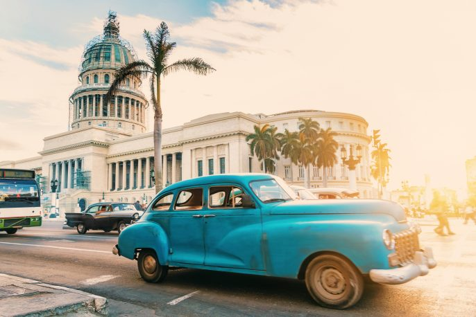 old blue american car in front of Capitol in Havanna