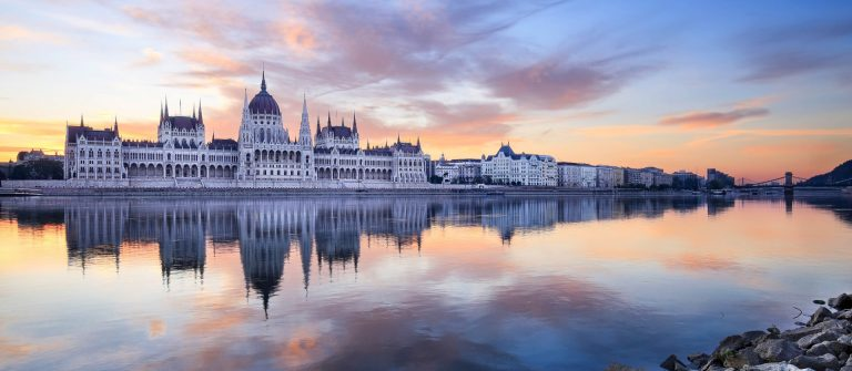 The Hungarian Parliament building in Budapest, Hungary at sunrise.