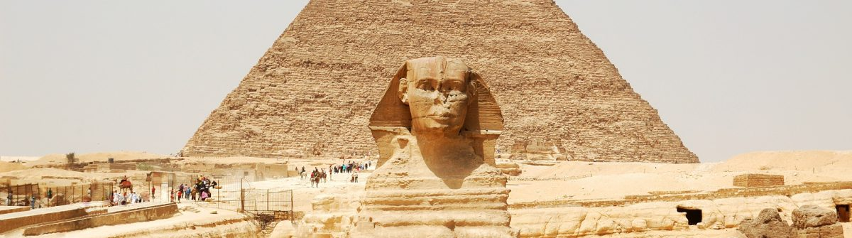 Spinx-face-on-the-Giza-pyramid-background-Cairo-Egypt_266356247
