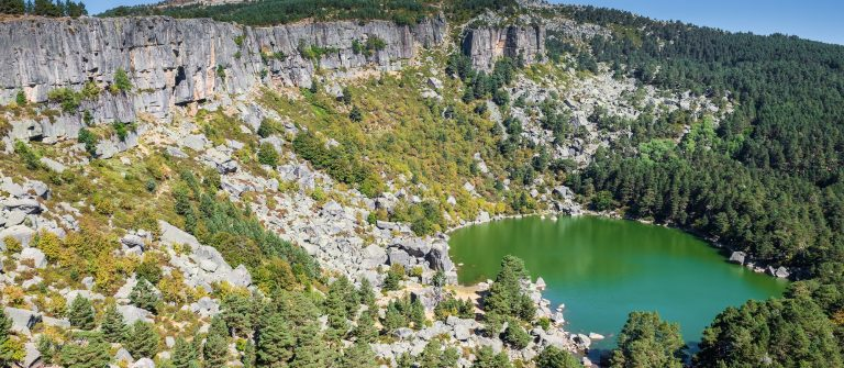 Mountain-landscape-with-Laguna-Negra-and-pine-forest-Soria-in-Spain-shutterstock_486008593