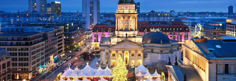 Aerial_view_onto_Christmas_market_at_Gendarmenmarkt-square_in_Berlin_iStock-504384970_1920x1280