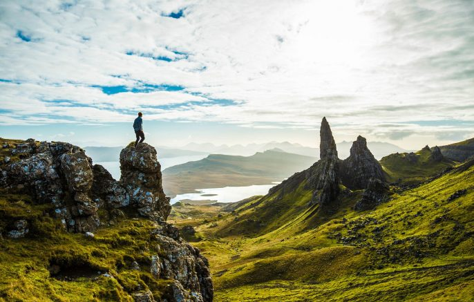 Hiker-looking-at-view-of-Scottish-highland-cliffs-Skye-iStock_000061488168_Large-2