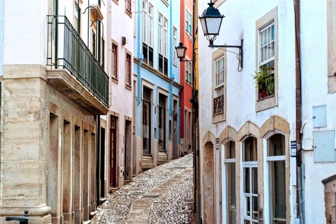 Old-and-narrow-street-of-Coimbra-city-in-Portugal_372415801