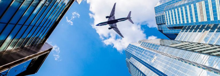 Skyscraper-with-a-airplane-iStock_32973438_XLARGE-2_1920x1280