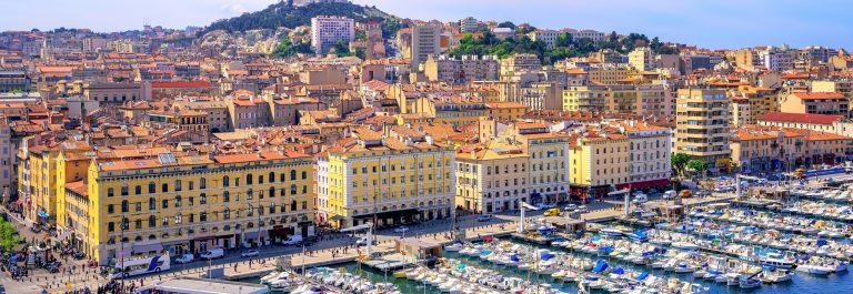 The-old-Vieux-Port-and-Basilica-Notre-Dame-de-la-Garde-in-the-historical-city-center-of-Marseilles-France_436865629