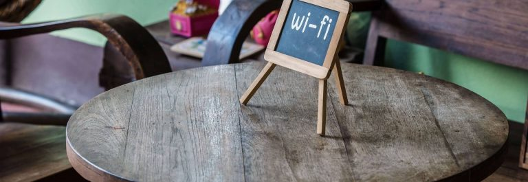 Wifi-sign-on-wood-table-in-public-cafe-shutterstock_330475616_1920x1281