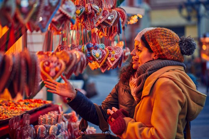 shutterstock_745087123_Friends-Buying-Candies-On-Christmas-Market_1920-1