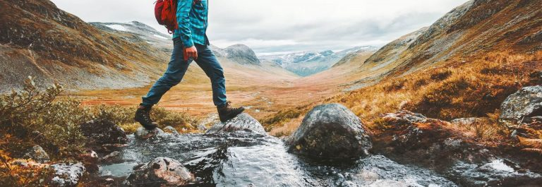 Man-solo-traveling-backpacker-hiking-in-scandinavian-mountains-active-healthy-lifestyle-adventure-journey-vacation-shutterstock_1090646606_1920x1280-1